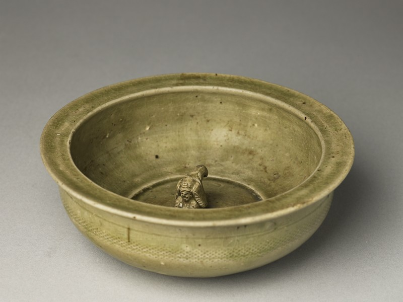 Greenware basin with small kneeling figure