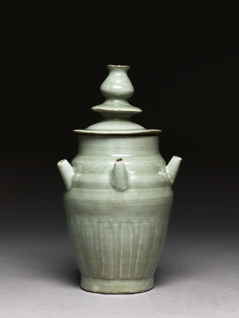 Greenware funerary jar with five spouts