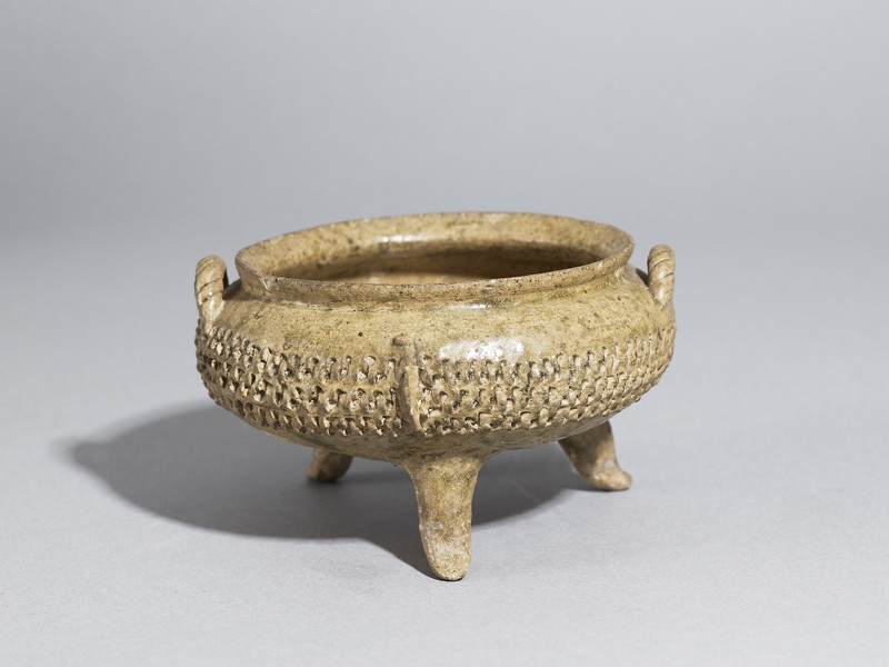 Greenware tripod bowl with impressed decoration (EA1956.385, oblique            )