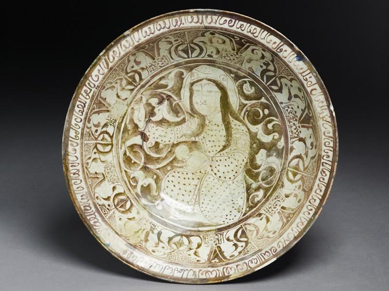 Dish with seated female figure against a foliate background (EA1956.52, top           )