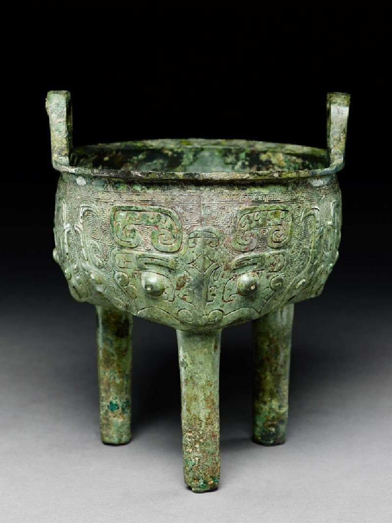 Ritual food vessel, or ding, with dragon and taotie masks (oblique            )