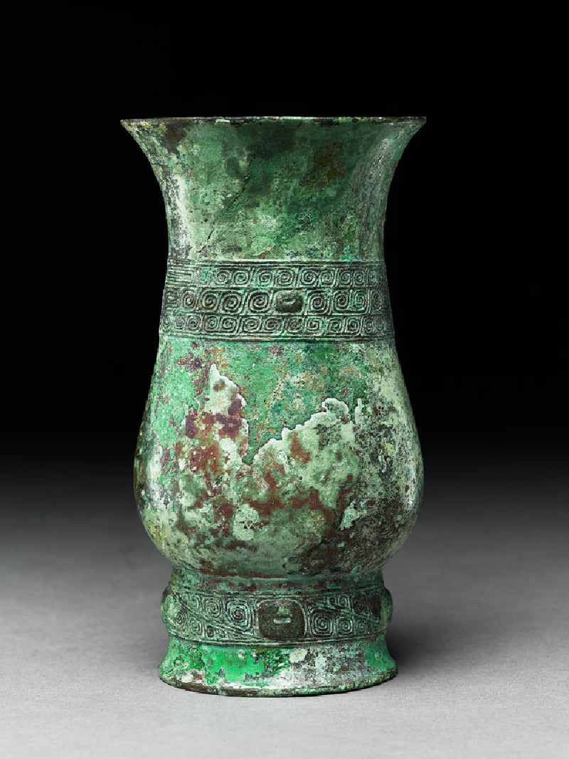 Ritual wine vessel, or zhi, with thunder-scroll pattern (side            )