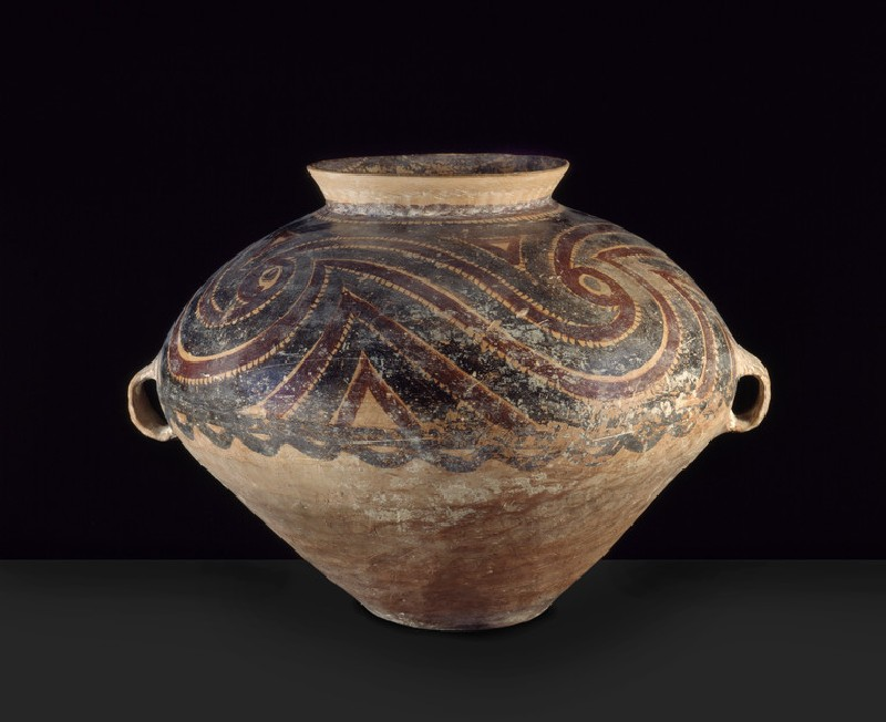 Burial urn with red and black swirls