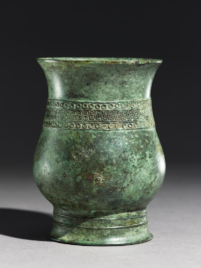 Ritual wine vessel, or zhi, with circles and S-shapes (side            )