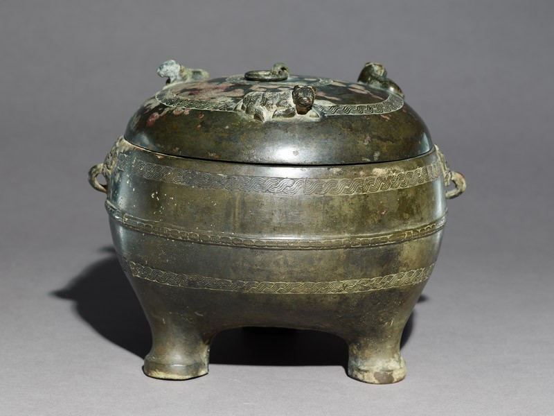 Ritual food vessel, or ding, with seated ox on the lid (EA1956.907, oblique            )