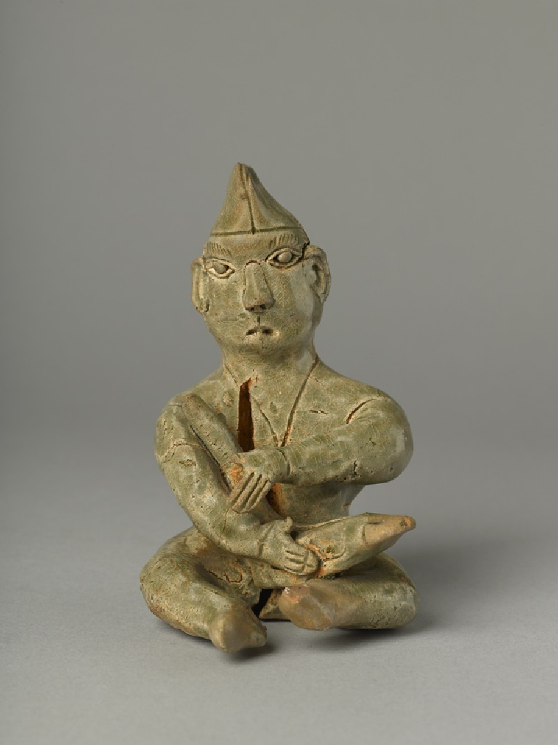 Greenware burial figure of man playing a harp