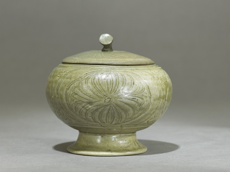 Globular greenware jar with lotus flower decoration