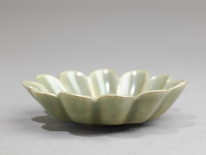 Greenware dish with fluted sides