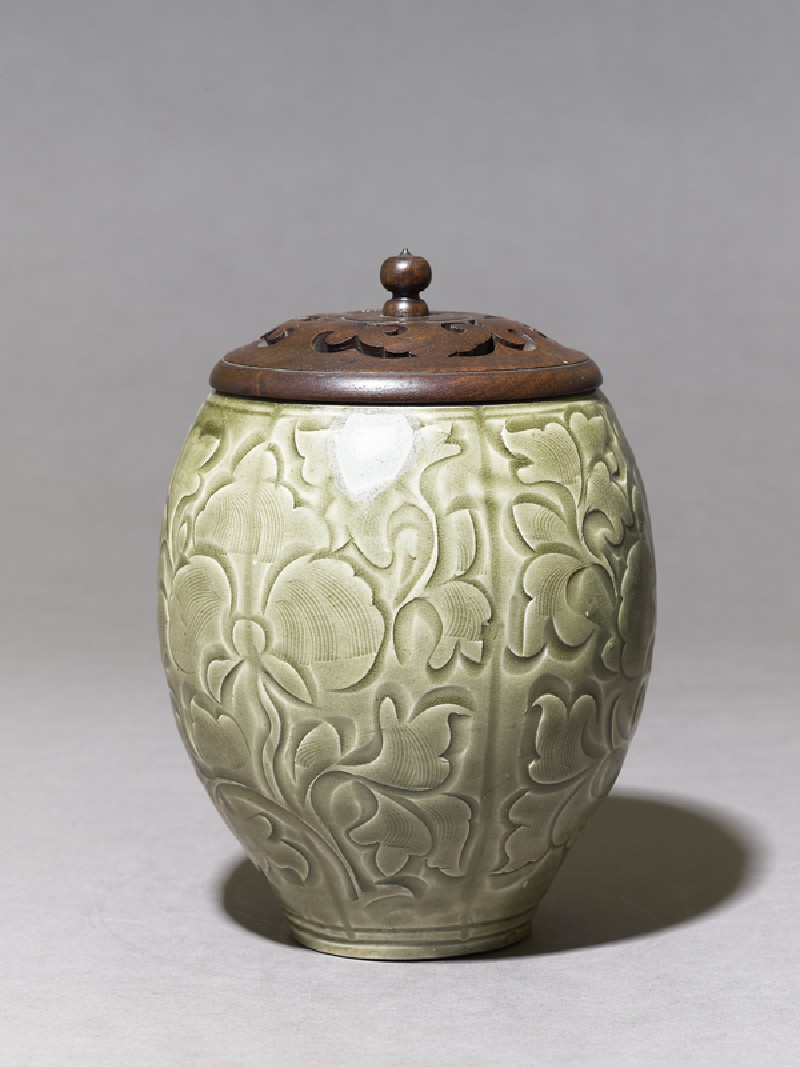 Greenware jar with floral decoration and modern lid