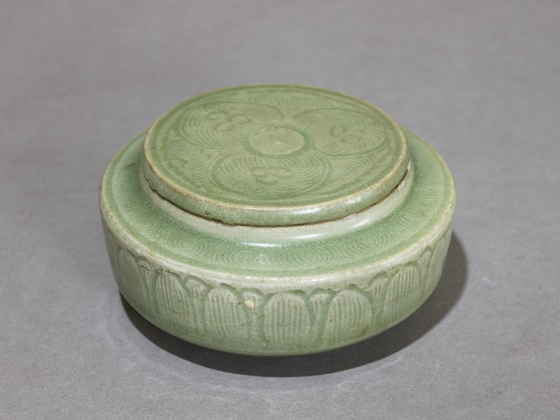 Greenware jar with stylized petals