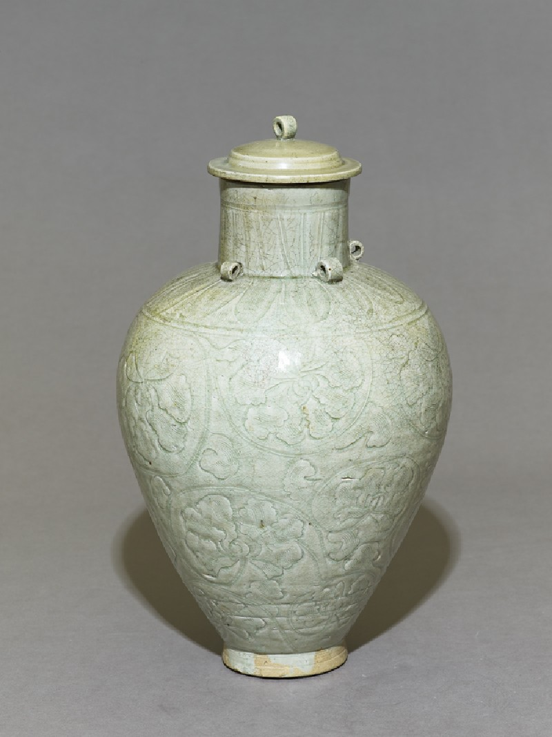 Greenware vase with lotus leaves