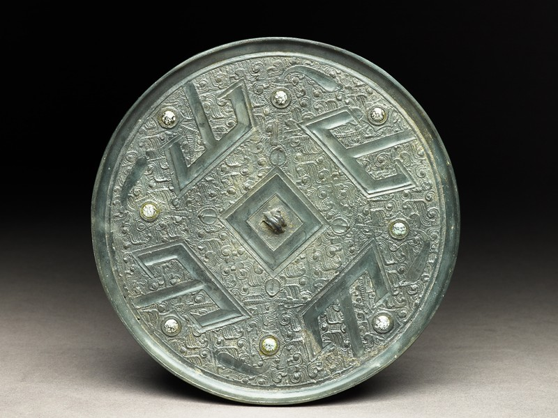 Mirror with nine directional points and T-shaped designs (EA1956.1562, front             )