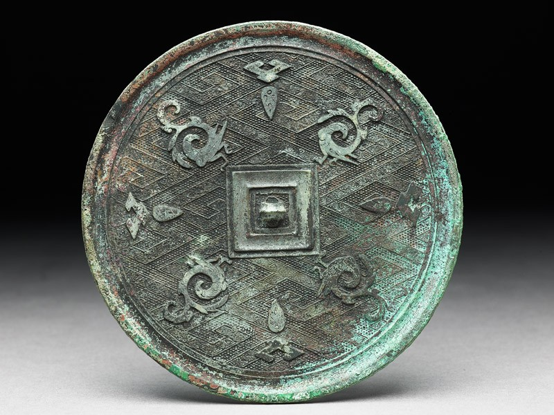 Ritual mirror with phoenixes on a lozenge ground (front             )