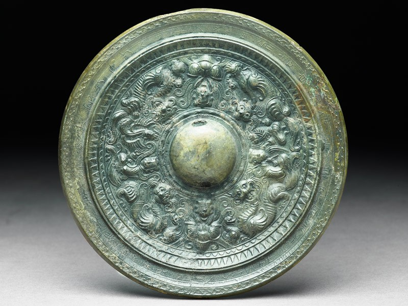 Ritual mirror with inscription, dragons, and clouds