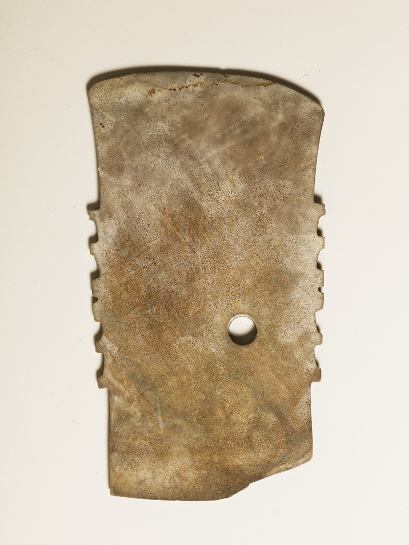 Notched ceremonial blade in imitation of a functioned axe (EA1956.1621, side             )