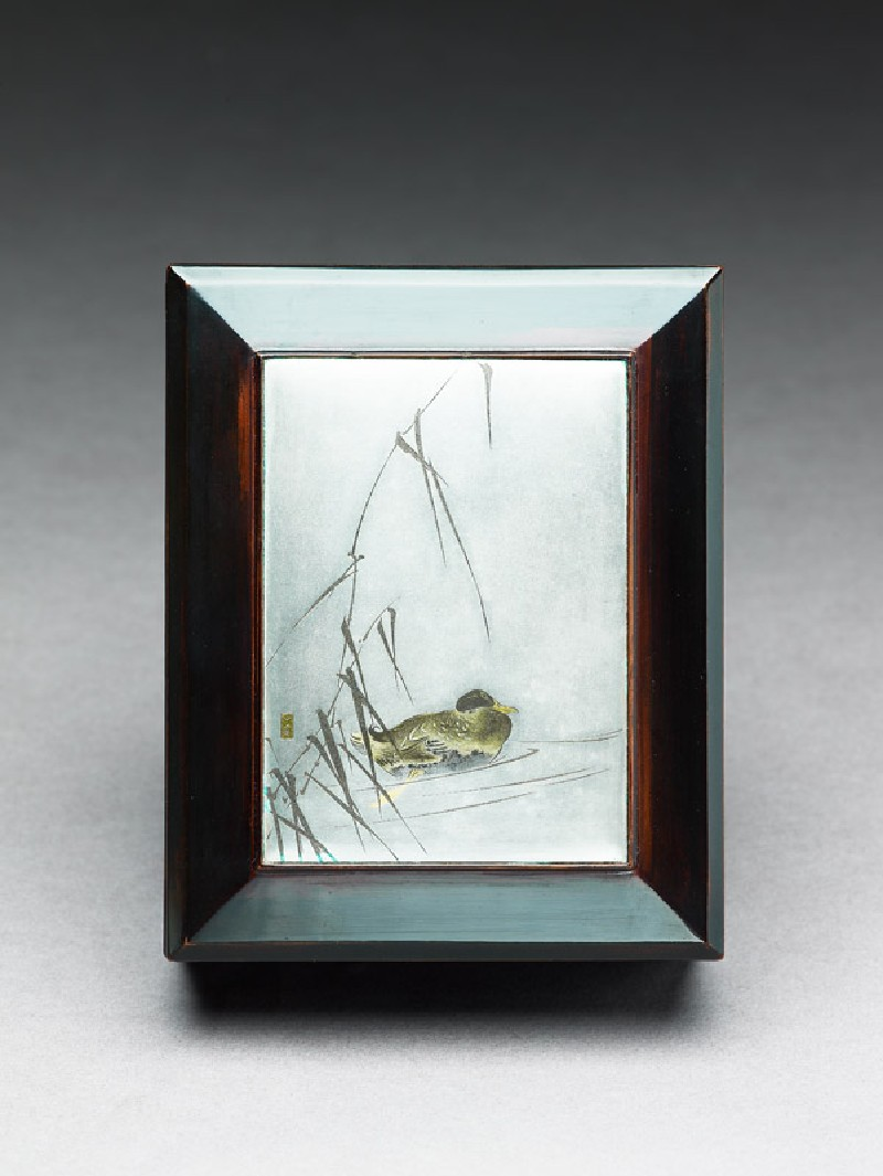 Box with plaque depicting a duck swimming past reeds (top             )