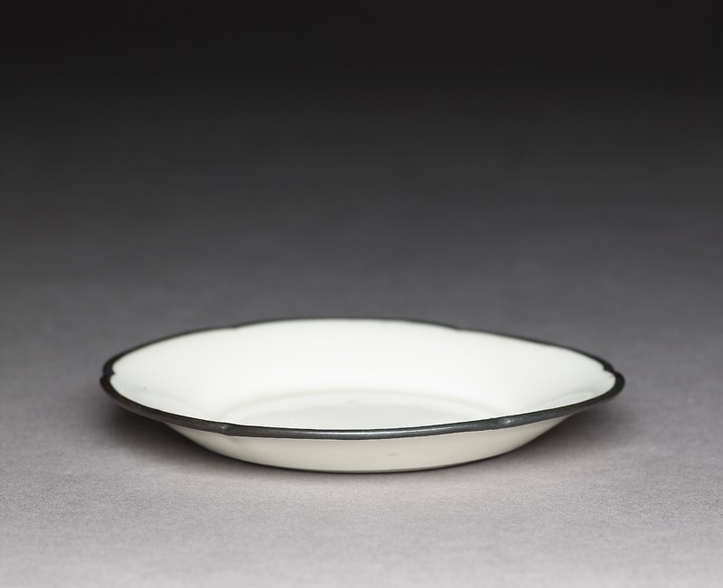 White ware dish with copper rim