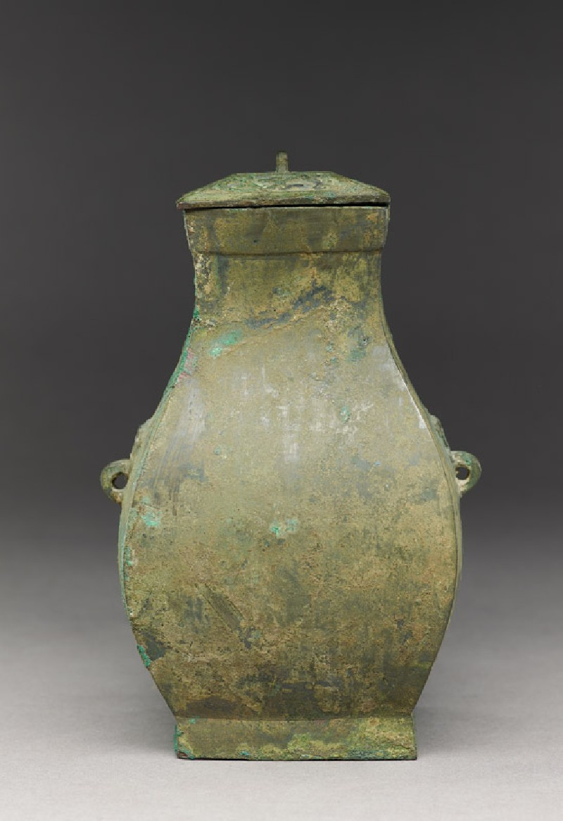 Square ritual wine vessel, or fang hu, with animal mask handles