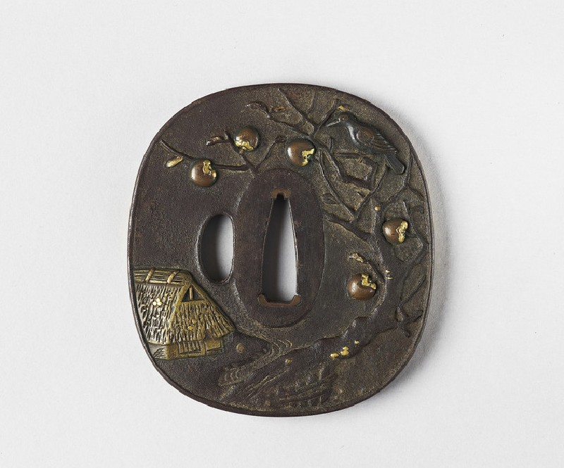 Rounded square tsuba with a farm house and a crow in a persimmon tree, and rice sheaves by a river and bridge on the reverse (EA1956.2066, front             )