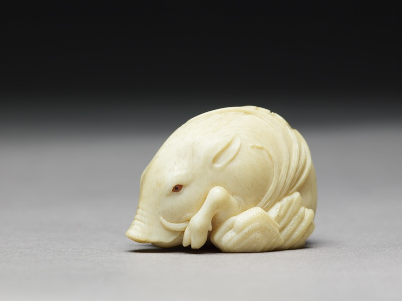 Netsuke in the form of a wild boar among grass