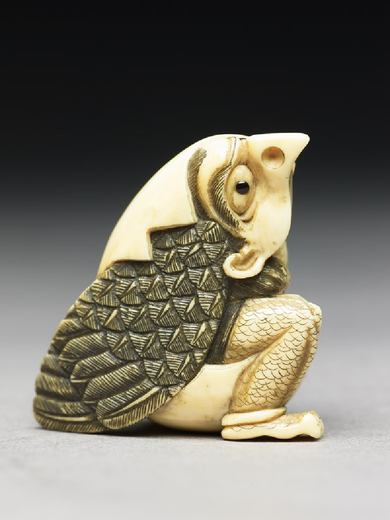 Netsuke in the form of a tengu mountain demon emerging from an egg (EA1956.3216, side             )