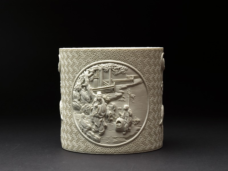 Brush pot with figures in high relief