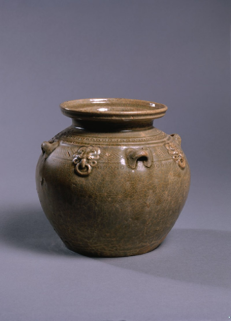 Greenware jar with four animal masks (oblique             )