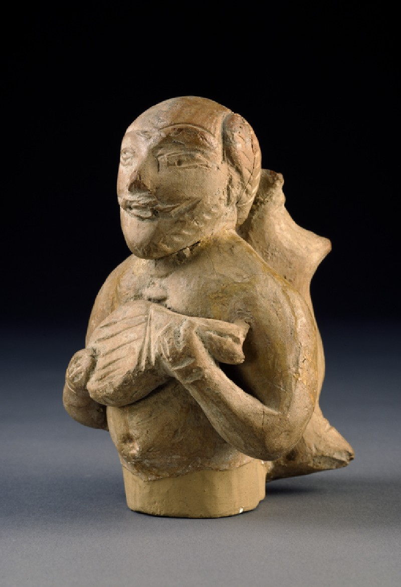 Figure of a musician carrying a water-skin (EA1958.116, oblique            )