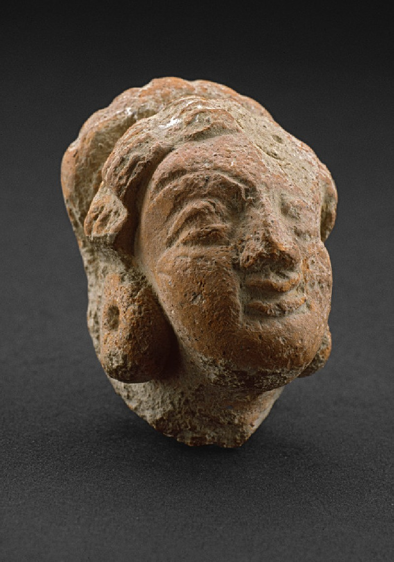 Head of a female figure (EA1958.12)