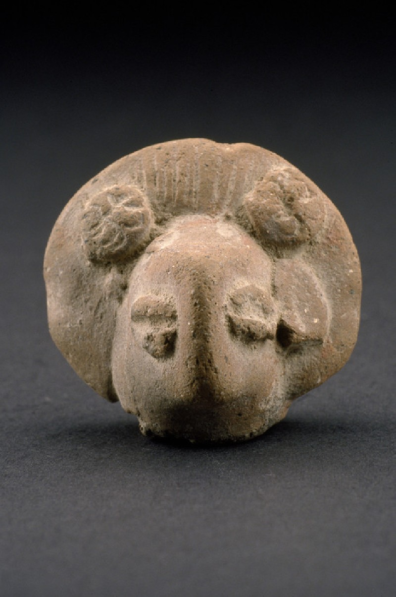 Head of a figurine, probably female