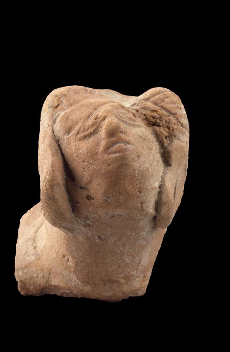 Head of a male figure (EA1958.52)