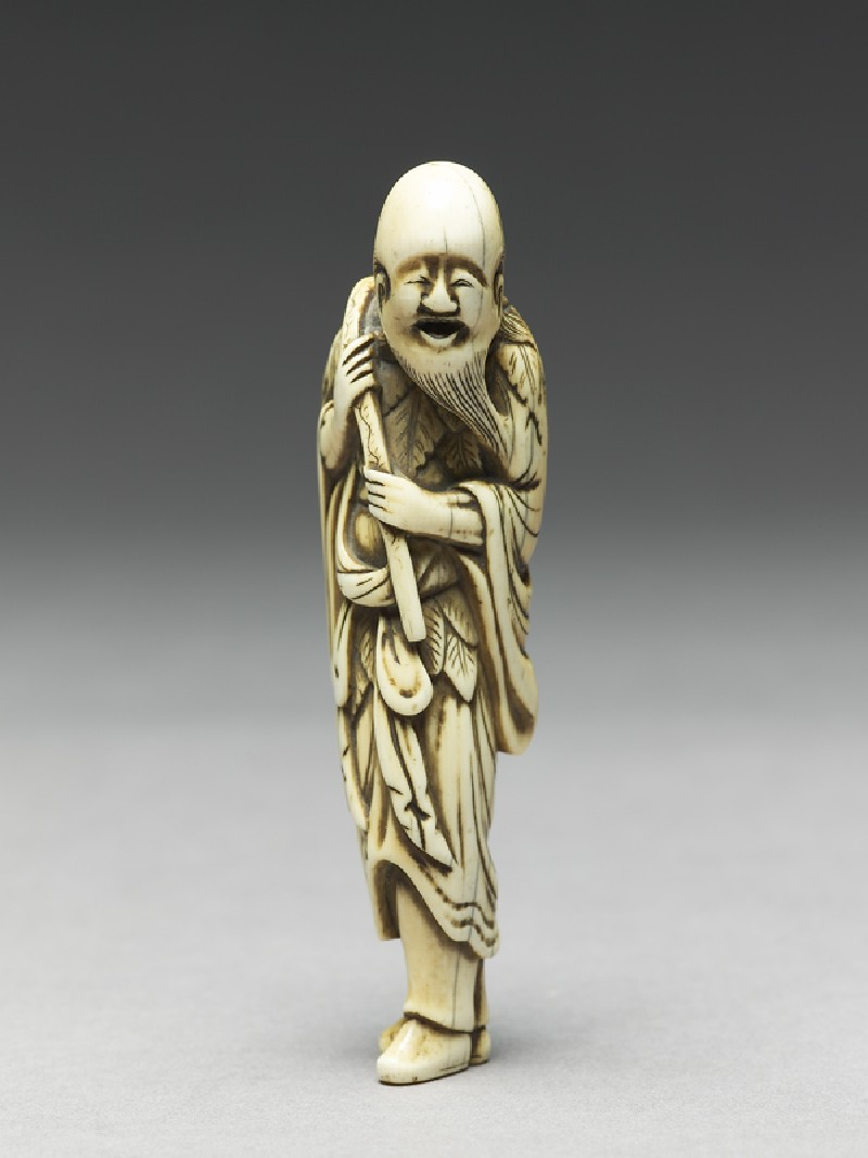 Netsuke in the form of Sennin, a Daoist immortal (side           )