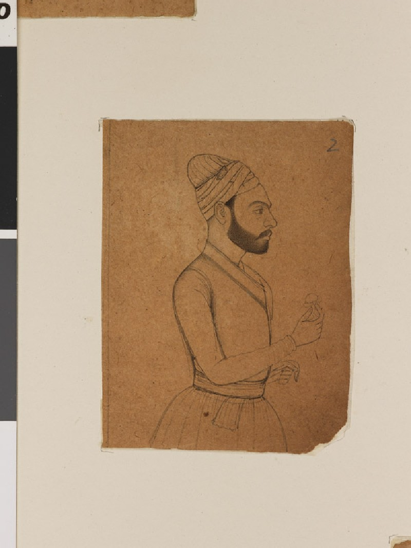 Bearded man holding a flower (front              )