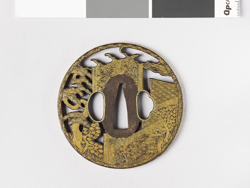 Round tsuba with design of pine trees and garden trellis