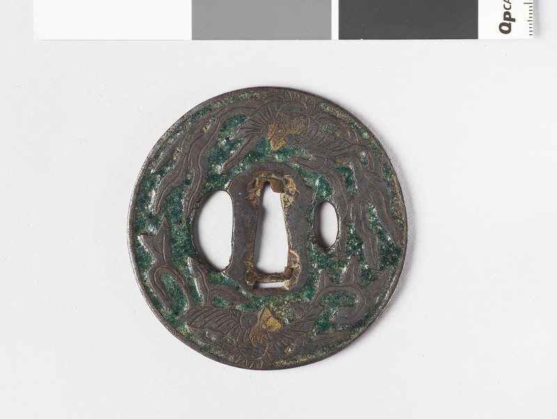 Round tsuba with design of phoenix and paulownia leaves (EA1962.172, front            )