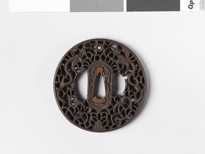 Round tsuba with design of dragons, tama (sacred jewel) and scrollwork (EA1962.173, front            )