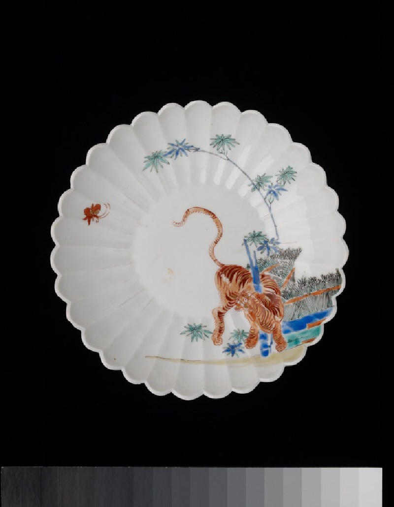 Fluted saucer dish with a tiger and butterfly