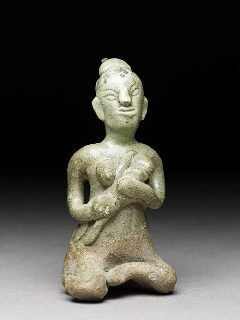 Greenware figure of mother and child