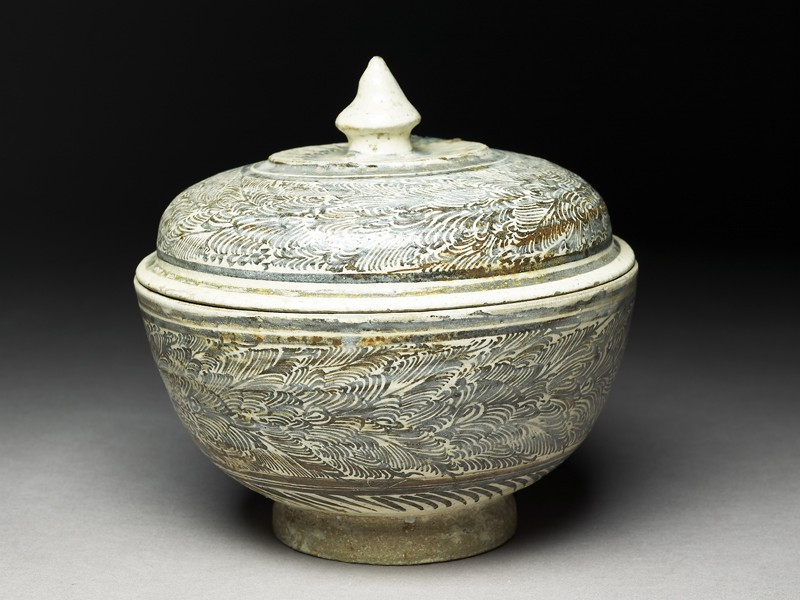 Covered bowl with feather-floral designs