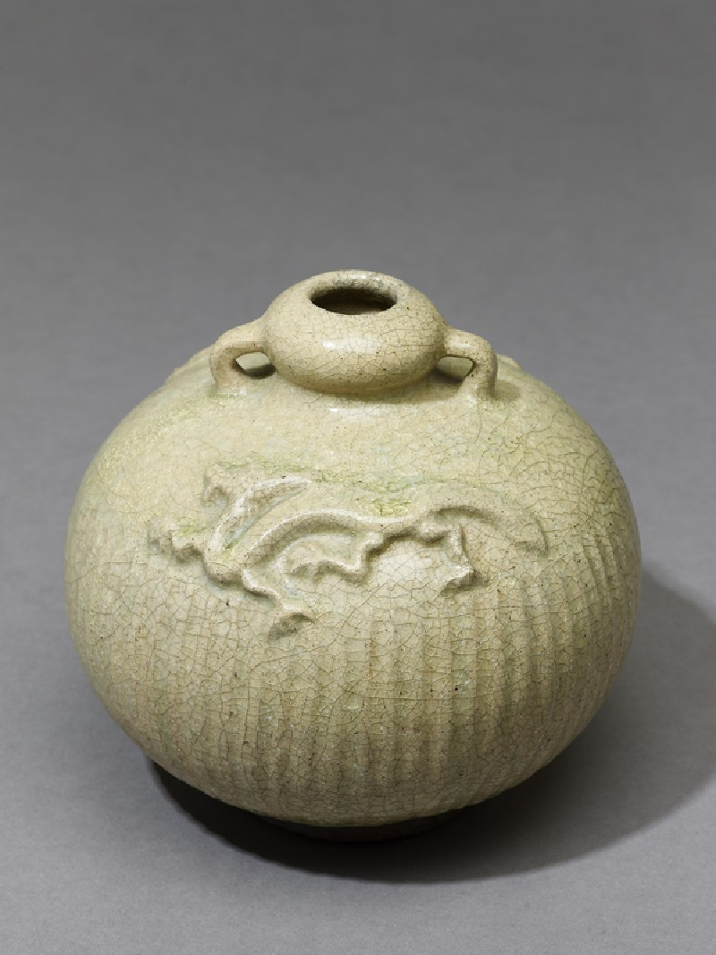 Greenware jar with dragons in relief