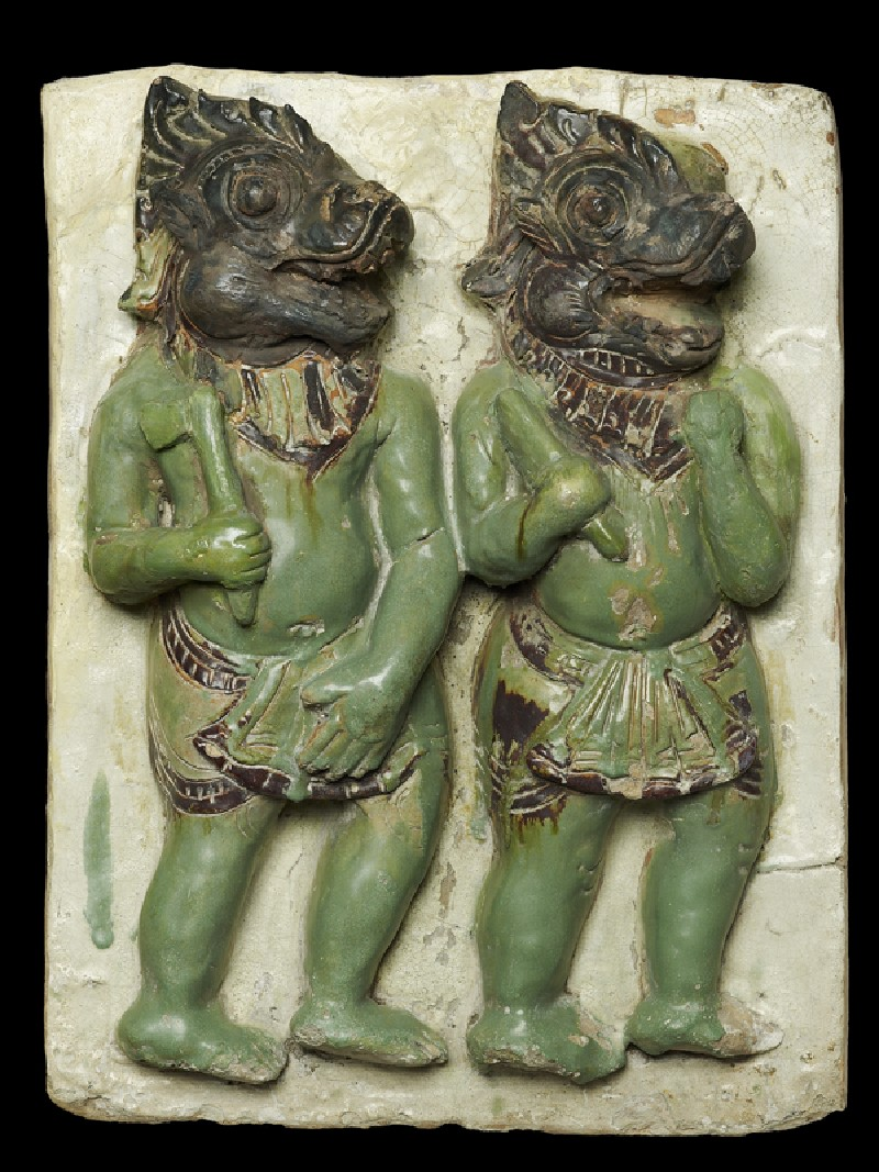 Plaque with demon-headed warriors (front            )