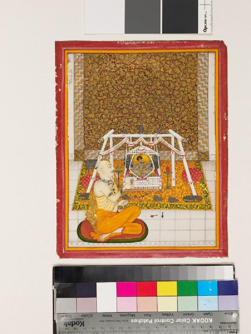 Priest at a Krishna shrine