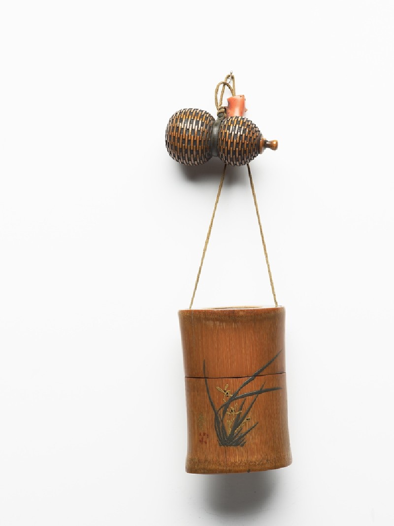 Tonkotsu, or tobacco container, attached to a gourd-shaped netsuke and an ojime