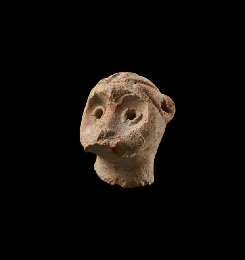Head of a figure, possibly a monkey