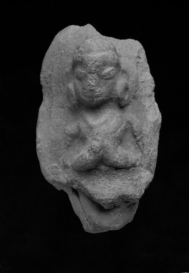 Plaque with a female figure with folded hands