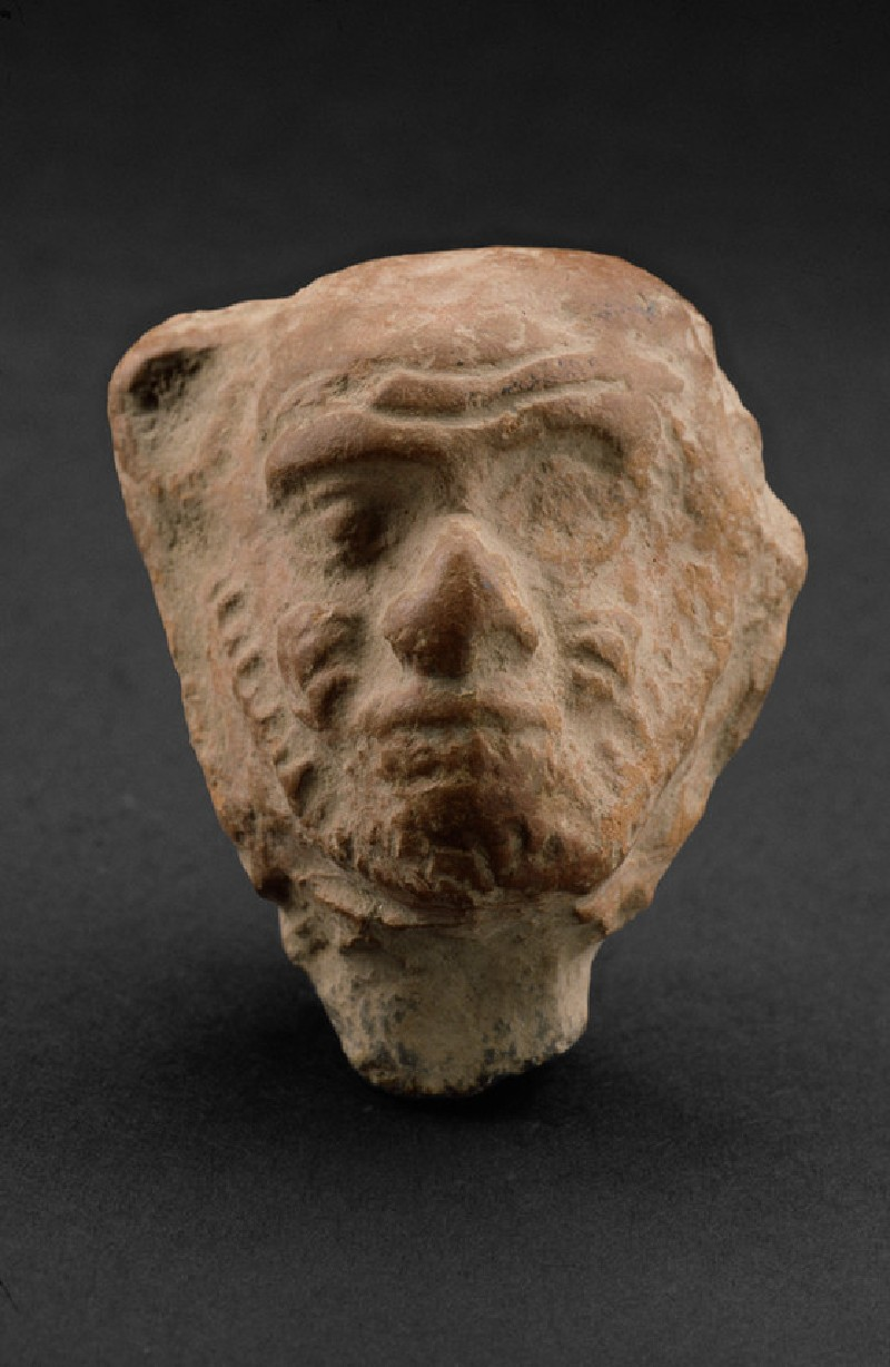 Head of a male figure with beard, possibly a grotesque