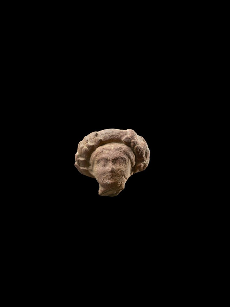 Head of a figure with wreath, possibly female (EA1967.95)