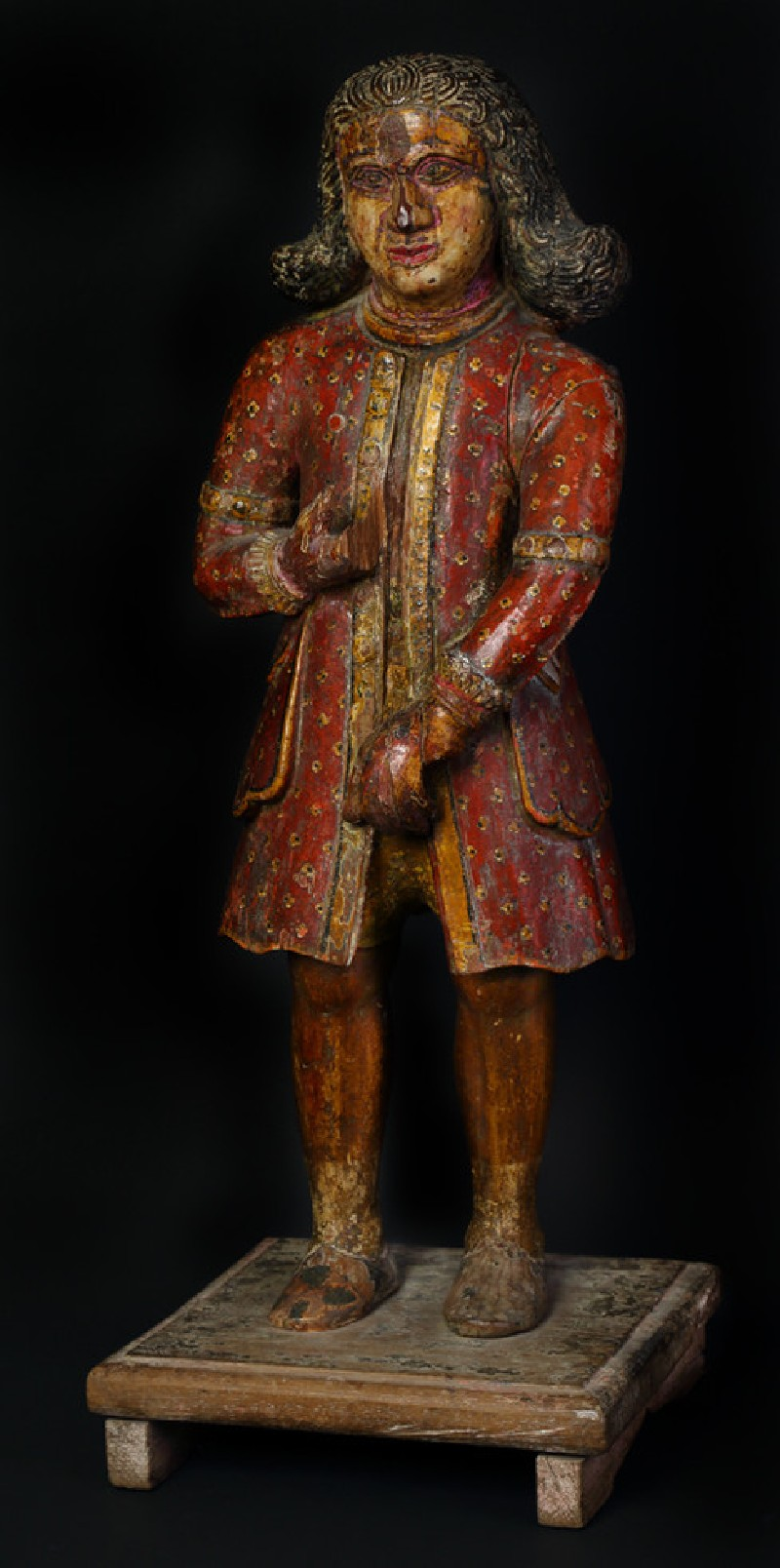 Figure of a standing Dutchman wearing a red coat (EA1968.42, oblique           )