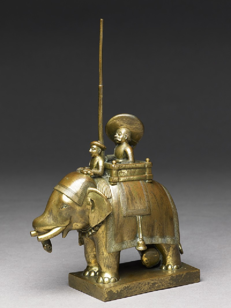 Toy soldier with elephant and driver (side             )