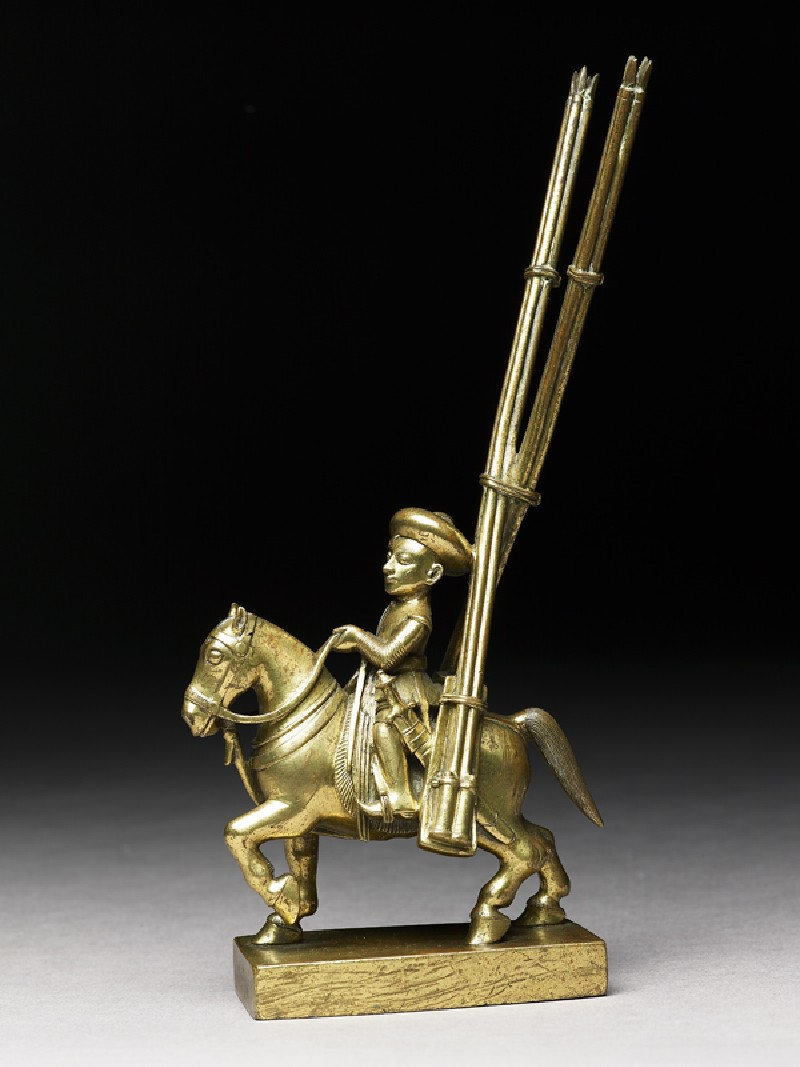 Toy soldier with horse and rocket-launchers (EA1969.44.e, side             )